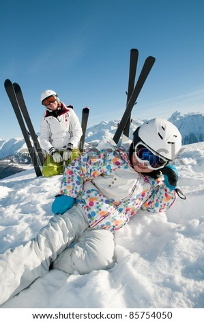 Skiers on winter vacation - stock photo