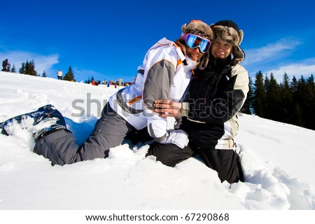 Skiers smile for the camera - stock photo