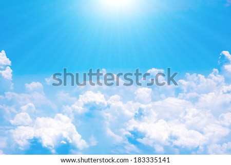 Skies and clouds with sunbeams airplane view - stock photo