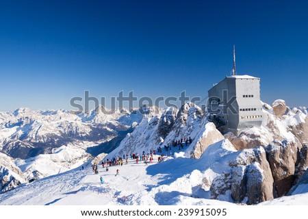 Skiing at the Marmolada glacier slopes at sunny winter day (Dolomites, Italy) - stock photo