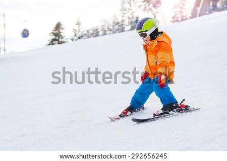 Skiing boy in ski mask and helmet on Sochi ski resort Krasnaya polyana in Russia - stock photo