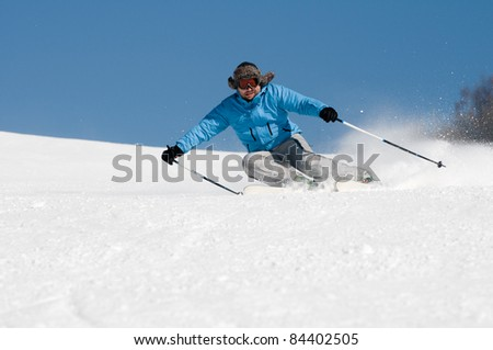 Skiing downhill (space for text) - stock photo