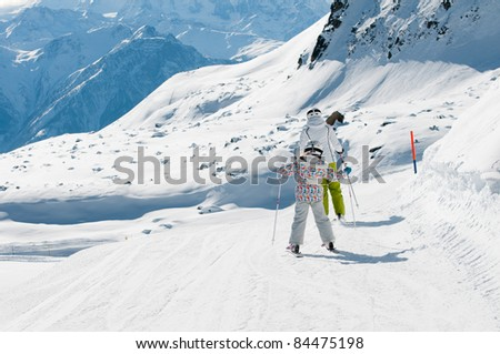 Skiing - family skiing downhill - (space for text)