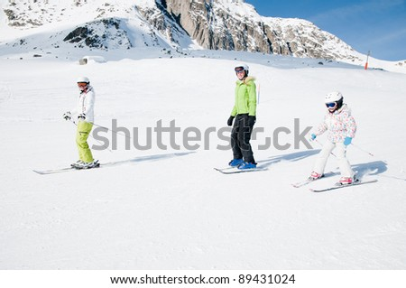 Skiing - female skiers on ski slope - stock photo