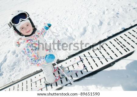 Skiing, little skier in ski school - stock photo