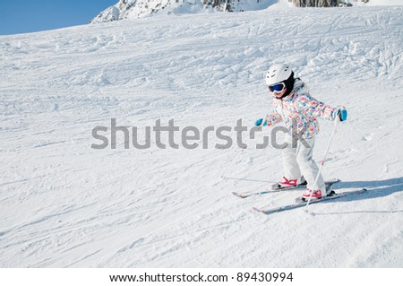 Skiing - little skier skiing downhill - stock photo