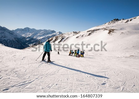 Skiing on the slopes of Schareck. Ski resorts near Heiligenblut in Austria have spectacular view on the highest peak of Austria i.e. Grossglockner.