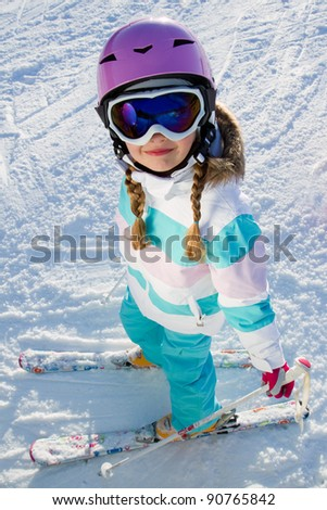 Skiing, portrait of beautiful young skier on ski slope - stock photo