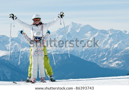 Skiing - portrait of female skiers in Swiss Alps (space for text ) - stock photo