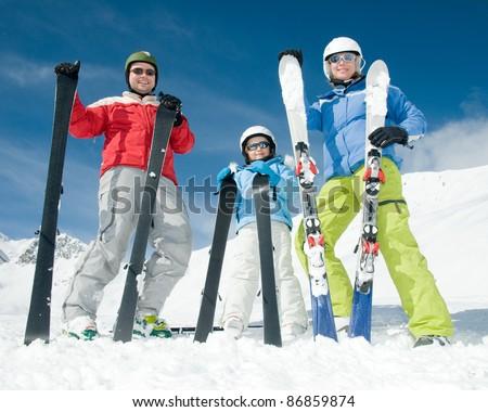 Skiing, portrait of sporty family - stock photo