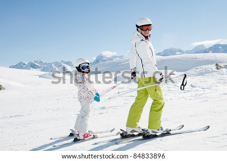 Skiing - ski lesson in winter resort - stock photo