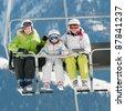 Skiing, ski lift - skiers on ski vacation - stock photo