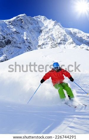 Skiing, Skier, Freeride in fresh powder snow - stock photo