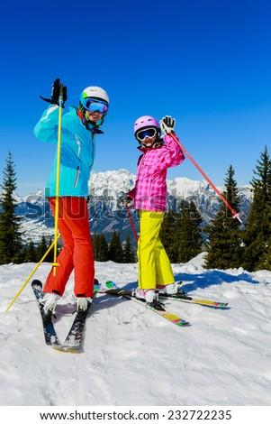 Skiing. Skiers enjoying winter vacation - stock photo