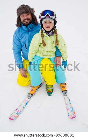 Skiing, skiers having fun on winter holiday