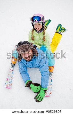 Skiing, skiers having fun on winter holiday - stock photo
