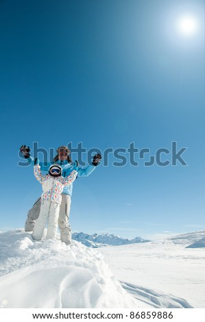 Skiing, skiers having fun on winter holiday (space for text, cover) - stock photo