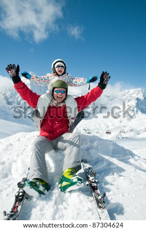 Skiing - skiers having fun on winter holiday  (space for text, cover)