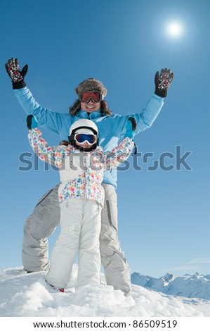 Skiing, skiers having fun on winter vacation (space for text, cover) - stock photo