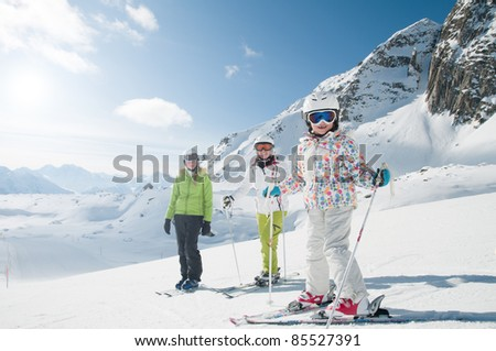 Skiing - skiers in winter resort - stock photo