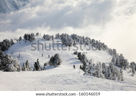Skiing slope in the French Alps - stock photo