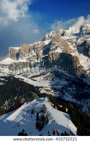 Skiing slopes of resort in Italian Dolomiten Alps on a sunny evening - stock photo