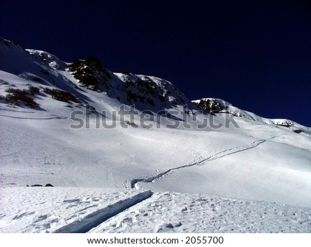 skiing track up hill into the mountains - stock photo