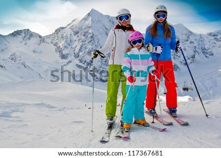 Skiing, winter - family skiers on ski slope - stock photo