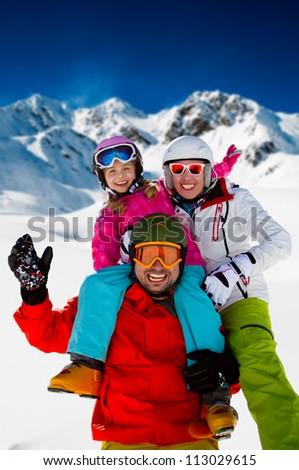 Skiing, winter fun - happy family ski team - stock photo