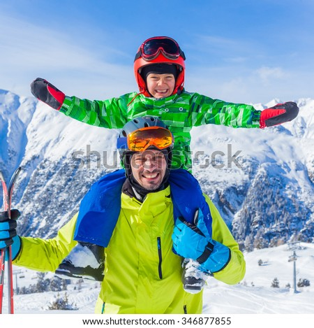 Skiing, winter fun - happy little boy with his father on ski holiday - stock photo