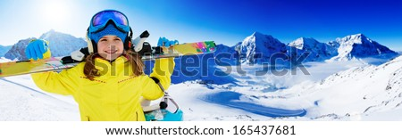 Skiing, winter fun, ski billboard -  lovely skier girl enjoying ski holiday - stock photo