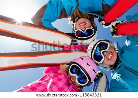 Skiing, winter fun - skiers enjoying ski holidays - stock photo