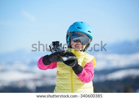 Skiing, winter fun,-smiling skier girl enjoying ski holiday - stock photo