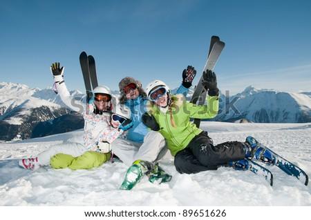 Skiing, winter - portrait of happy family on ski holiday - stock photo