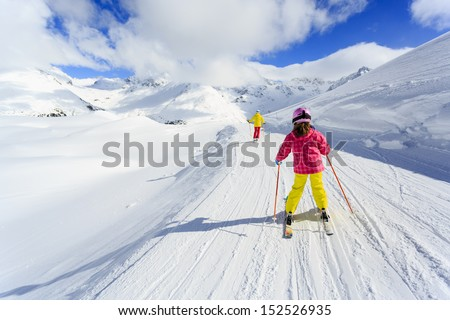 Skiing, winter, ski lesson - skiers on ski run - stock photo