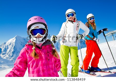 Skiing, winter - skiers on mountainside - stock photo