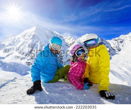 Skiing, winter, snow, skiers - family enjoying winter vacations - stock photo