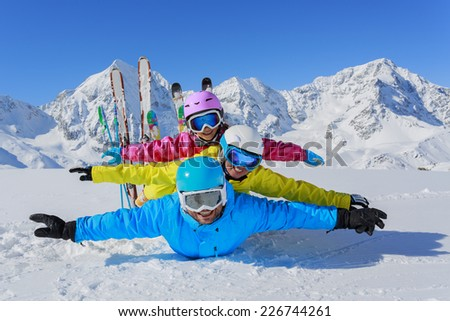 Skiing, winter, snow, skiers, sun and fun - family enjoying winter vacations - stock photo
