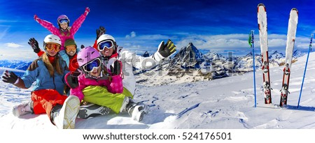 Skiing, winter, snow, sun and fun - family enjoying winter vacations