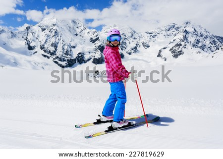 Skiing, winter sport - child skiing  - stock photo