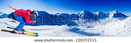 Skiing, winter sport  - skier on mountainside, panorama - stock photo