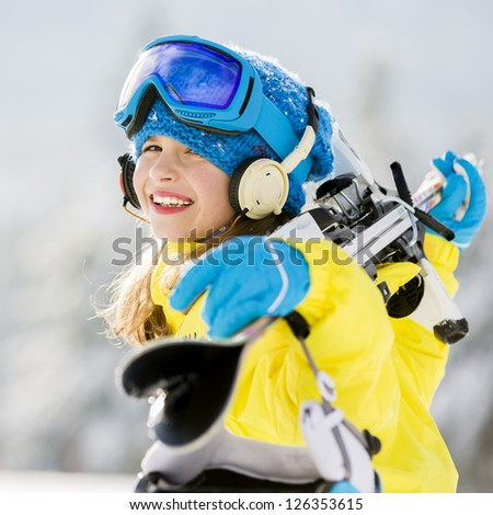 Skiing, winter sports - portrait of young skier - stock photo