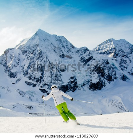 Skiing, winter, woman skiing downhill - stock photo