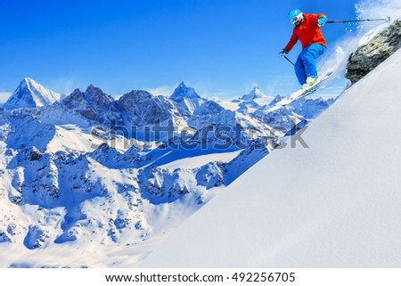 Skiing with amazing view of swiss famous moutains in beautiful winter snow. The matterhorn and the Dent d'Herens. In the background Castor and Pollux. In the foreground the Grand Desert glacier.