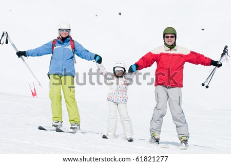 Skiing with parents - stock photo