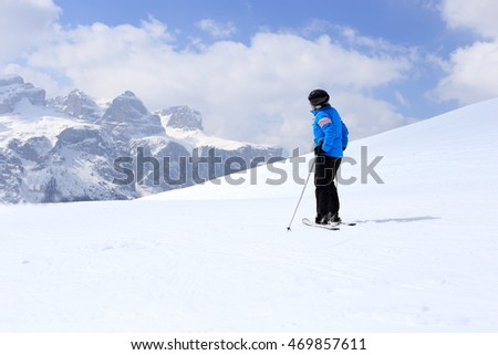 skiing woman is looking to peaks in the alps