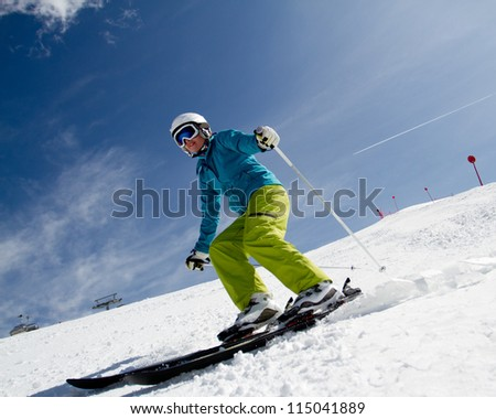 Skiing - woman skiing downhill - stock photo