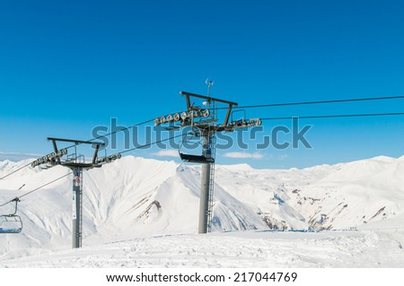 Skilift on ski resort during winter on bright day - stock photo