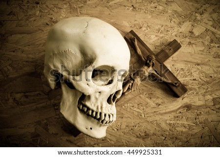 Skill whit jesus and the cross on wooden background,Faith belief and hope concept - stock photo