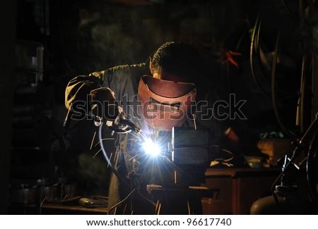 skilled working factory welder. - stock photo